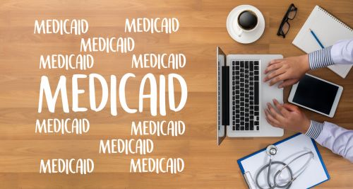 Medicaid written near a laptop and stethoscope. - Asset Protection & Elder Law of Georgia