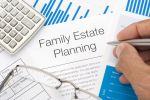 Close up of a Family Estate planning document with writing hand