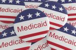 Pile of Medicaid Buttons With US Flag